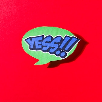 Oui, bulle de dialogue verte comique sur fond rouge