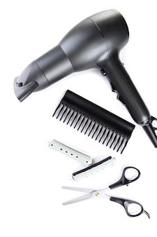 Outils de coiffeur professionnel, isolés sur blanc