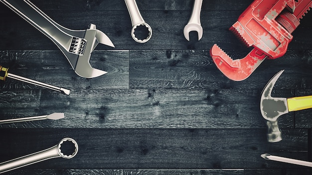 Outils placés sur le plancher en bois