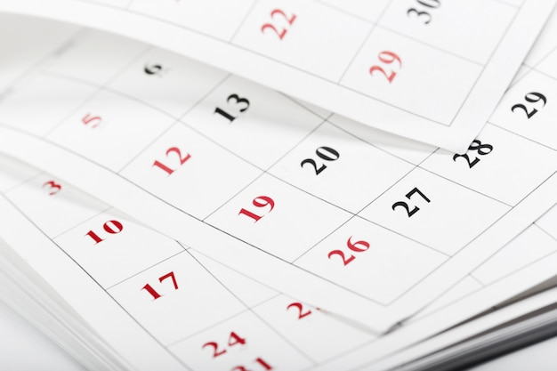 Pages de calendrier bouchent le concept de temps commercial