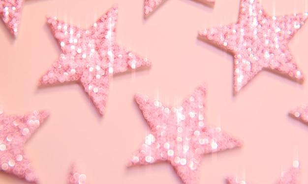 Paillettes brillantes roses floues étoiles lueur fond texture étincelante légère