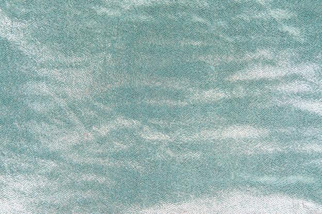 Paillettes brillantes turquoises texturées à l'arrière-plan