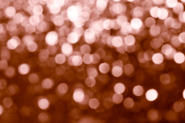 Paillettes de cuivre brillant flou texturé