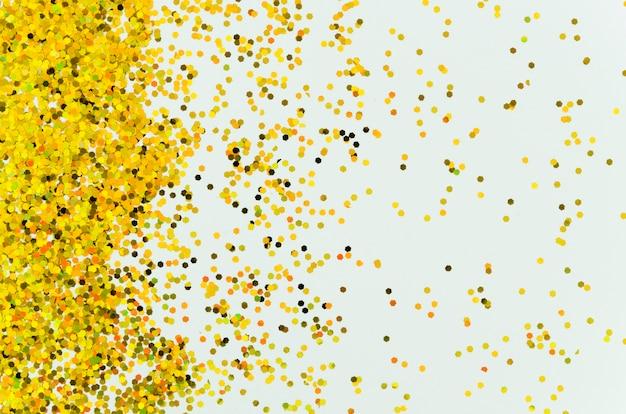 Paillettes dorées abstraites sur fond bleu