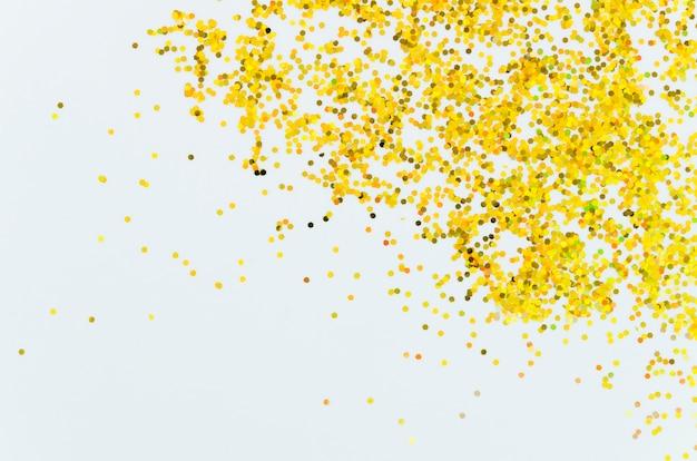 Paillettes dorées abstraites avec fond d'espace copie
