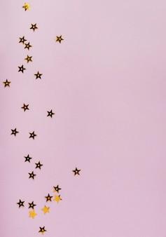 Paillettes dorées étoiles avec espace de copie