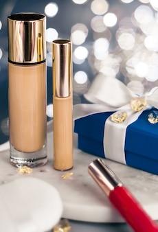 Paillettes de noël de marque cosmétique et concept de blog girly fond de teint de fond de teint anti-cernes...