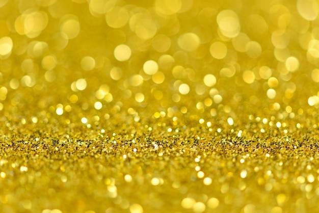 Paillettes d'or avec sol et mur de bokeh en perspective.