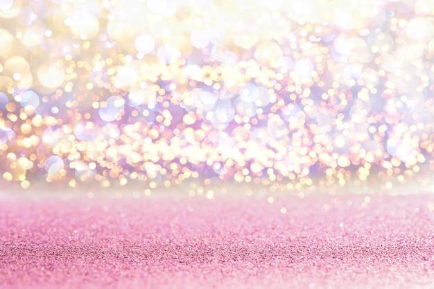 Paillettes roses lumières vintage texture fond bokeh. défocalisé