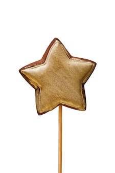 Pain d'épice en forme d'étoile de couleur or isoler sur un fond blanc
