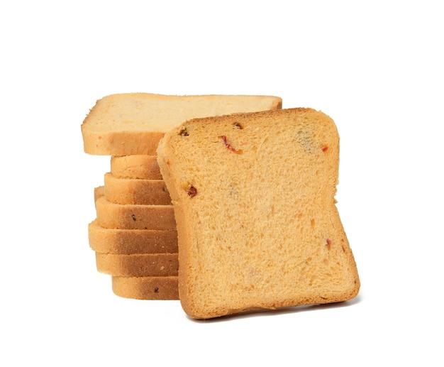 Pain de farine de blé blanc tranché avec des tomates. morceaux carrés pour sandwich isolé sur fond blanc
