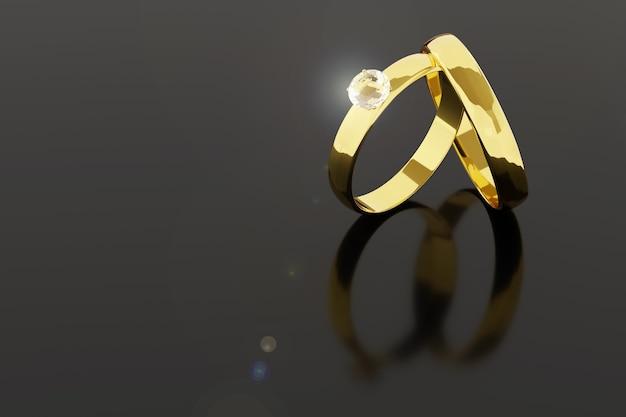 Paire d'alliances en or et diamants isolés sur fond noir.