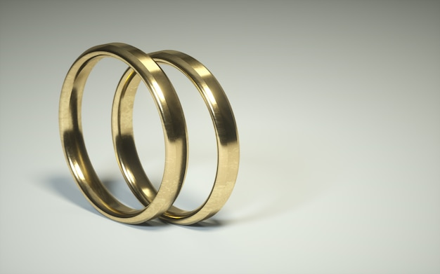 Paire d'une bague de mariage en or 3d. alliances. la relation sonne sur un fond blanc