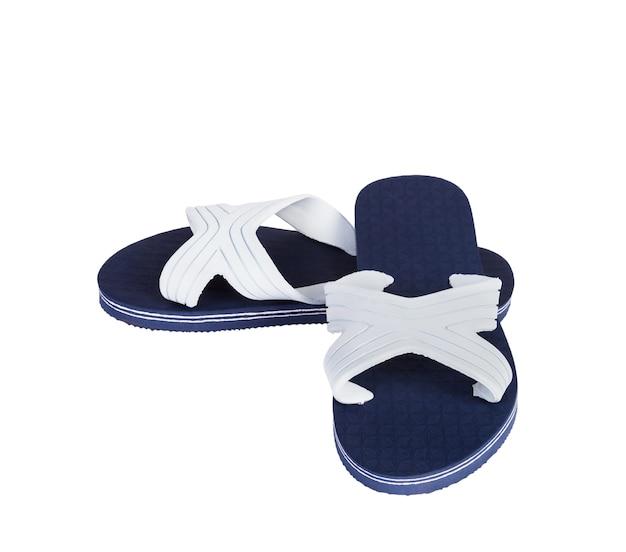 Une paire de pantoufles bleues et blanches