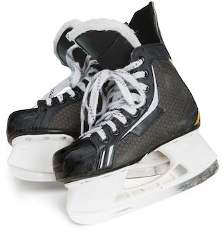 Paire de patins de hockey sur glace noirs, isolés sur fond transparent