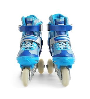 Paire de patins à roulettes, isolé sur blanc