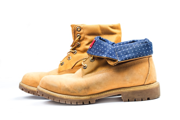 Paire de vieilles bottes de travail jaunes, nostalgiques