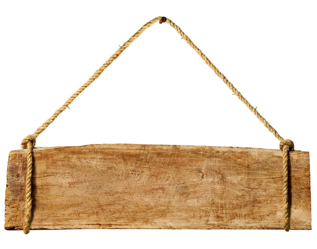 Panneau en bois suspendu à un clou rouillé.