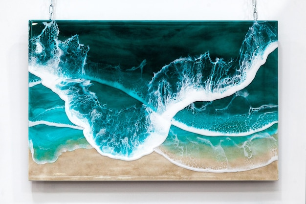Panneau mural avec une marée au bord de la mer en résine époxy.