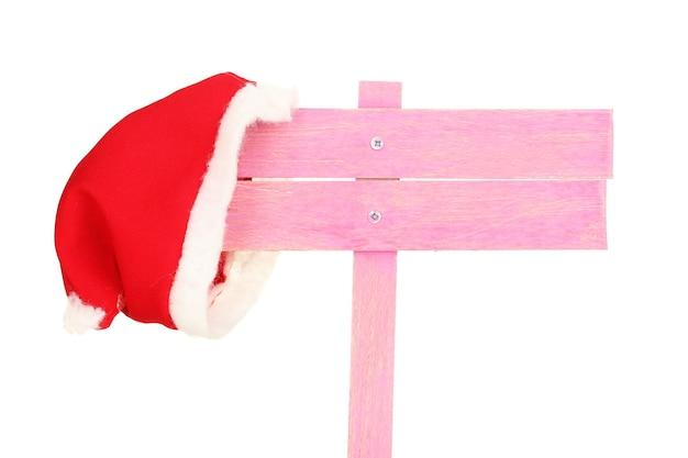 Panneau de signalisation en bois avec bonnet de noel isolé