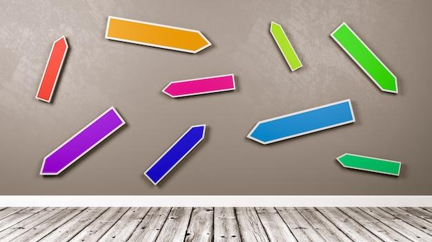Panneau de signalisation de flèches directionnelles colorées contre mur gris