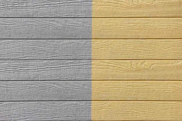 Panneaux de bois jaune gris design fond de texture de mur.