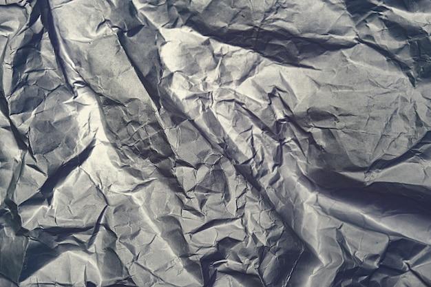 Papier abstrait brillant froissé gris