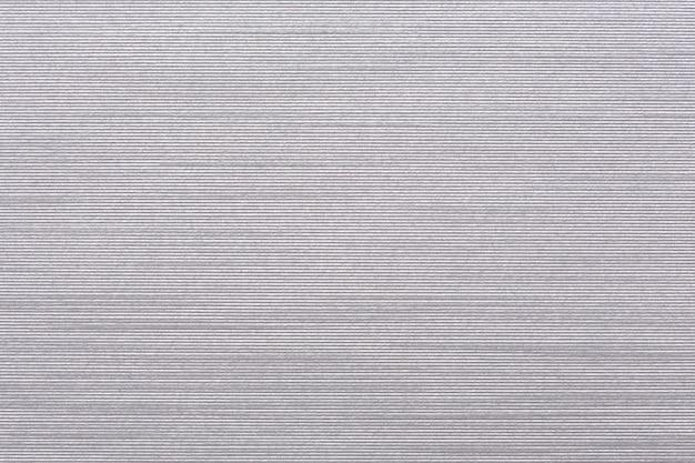 Papier blanc gaufré avec motif de lignes parallèles. texture de haute qualité en très haute résolution