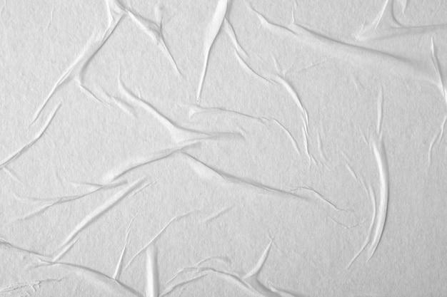 Papier blanc avec des plis. texture du papier.