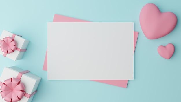 Le papier blanc vierge est placé sur du papier rose avec un coeur rose et une boîte cadeau blanche fermée avec un ruban rose sur une table cyan. concept de la saint-valentin