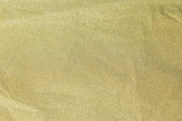 Papier brillant de paillettes d'or être froissé pour fond de noël, concept de célébration.