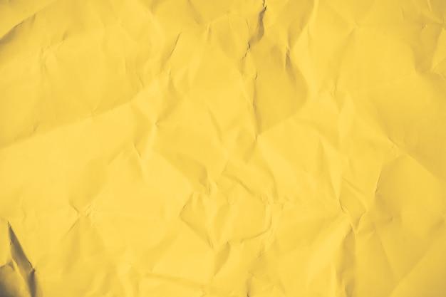 Papier brun froissé abstrait papier brun jaune fond clair lumière