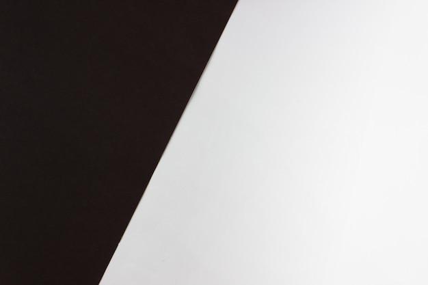 Papier de couleur brun foncé et texture blanche. coup de fond à deux tons.