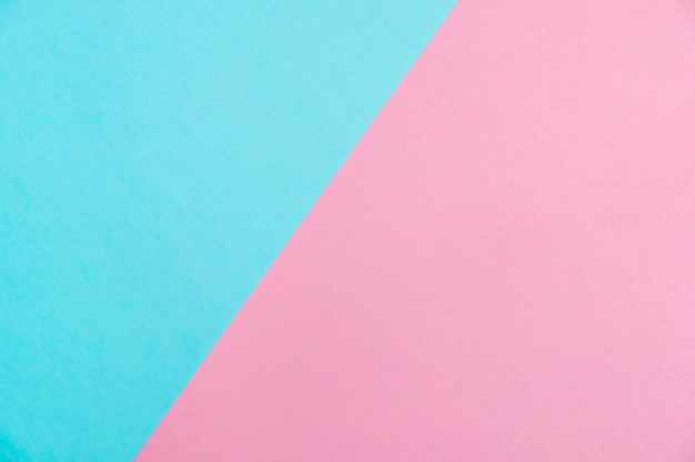 Papier de couleur pastel plat poser la vue de dessus, texture d'arrière-plan, rose et bleu.