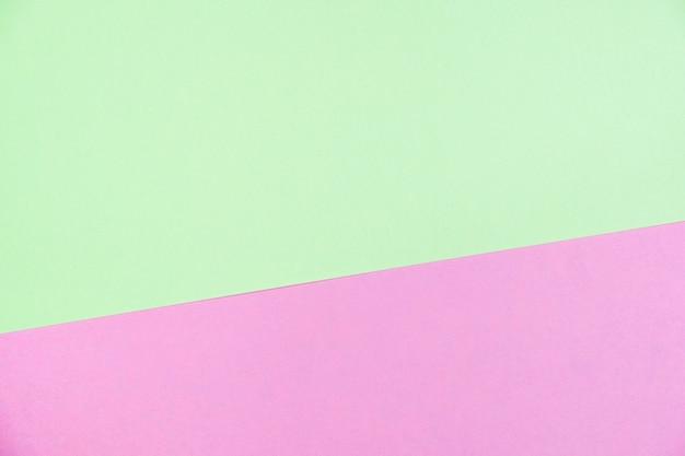 Papier de couleur pastel plat poser la vue de dessus, texture d'arrière-plan, vert et rose