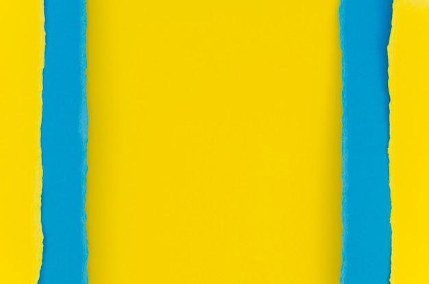 Papier déchiré jaune et bleu