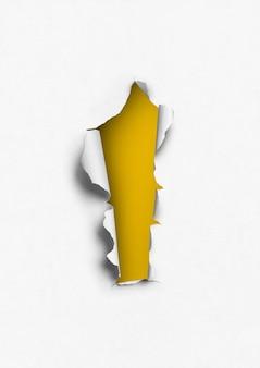 Papier déchiré avec trou jaune.