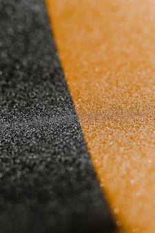 Papier d'emballage doré et noir pailleté