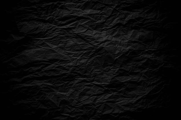 Papier froissé noir foncé bouchent fond de texture