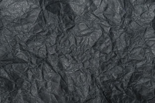 Papier froissé noir texturé pour les superpositions de produits ou les motifs de toile de fond