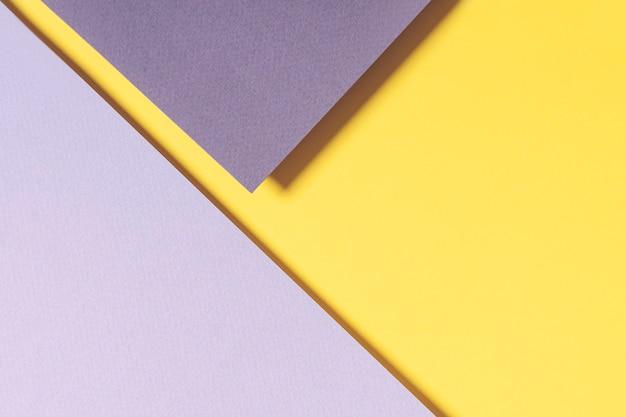 Papier géométrique abstrait dans des couleurs jaunes et grises