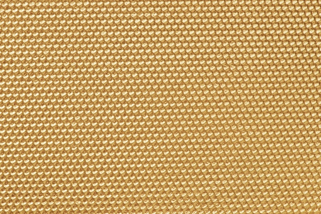 Papier peint motif nid d'abeille de couleur dorée