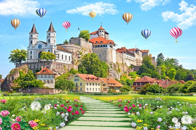 Papier peint mural bâtiment avec jardin et fleurs paysage ballons à air colorés dans le ciel