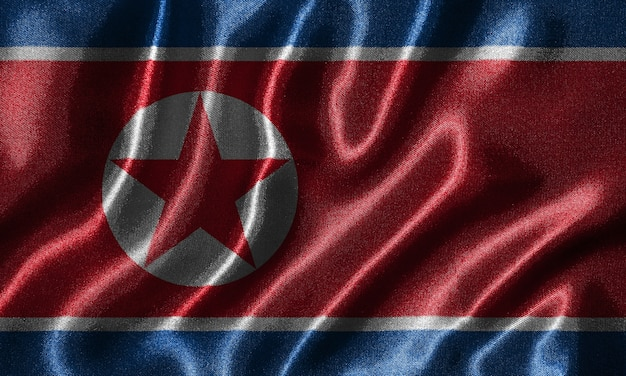 Papier peint par le drapeau de la corée du nord et agitant le drapeau par le tissu
