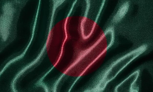Papier peint par le drapeau du bangladesh et agitant le drapeau par le tissu