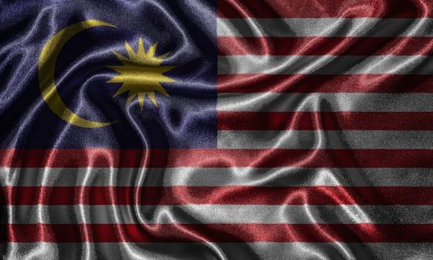 Papier peint par le drapeau de la malaisie et agitant le drapeau par le tissu