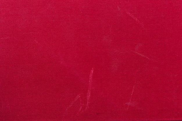 Papier peint de texture brillante du livre à couverture rigide rouge