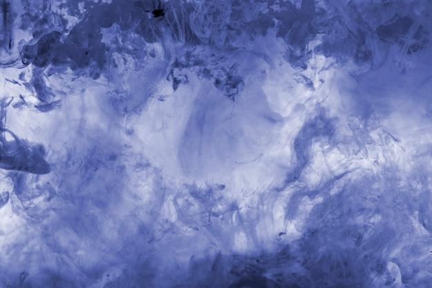 Le papier peint avec tourbillon d'encre de couleur dans l'eau, mélange de peinture abstraite
