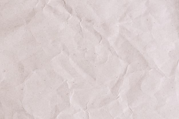 Papier recyclé brun abstrait froissé pour le fond, pli de textures de papier brun pour la conception