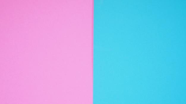 Papier vide dans la couleur du ciel rose et bleu pour le fond.